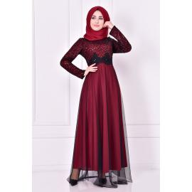 A burgundy red evening dress decorated with sparkles