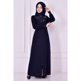 A navy abaya with glitter details on the fabric
