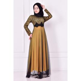 Mustard yellow evening dress decorated with sparkles