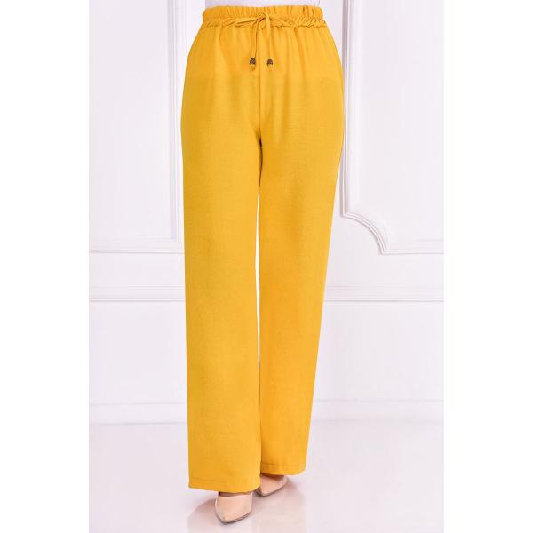 Mustard yellow pants with an elasticated belt
