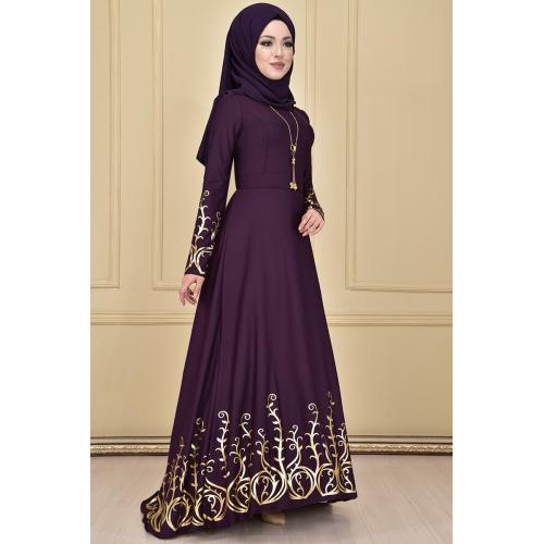 Evening dress ,embroidered in gold, purple color