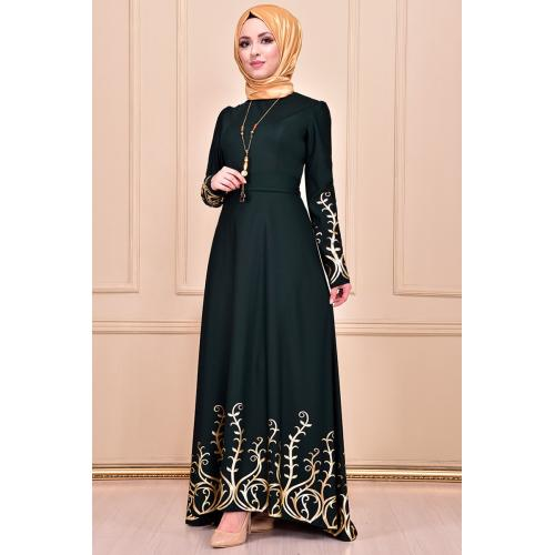 Evening dress ,embroidered in gold, emerald green color